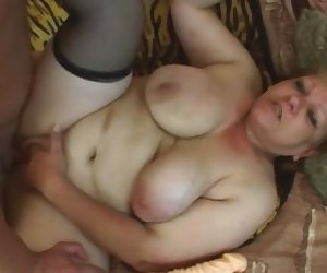Fat granny Venuse takes younger cock on couch