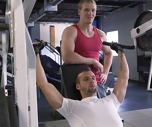 Jocks roughly pounding after workout in gym