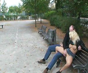 Horny couple fucking on public bench