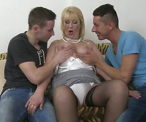Horny housewife fucking and sucking two guys at once