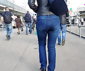 MILF's ass in black leather jacket