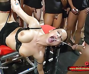 Dirty brunette whore used as a toilet in a huge gangbang