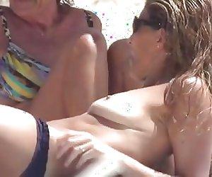 Milf sunbathing topless