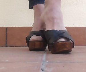 Playing with heels of wife